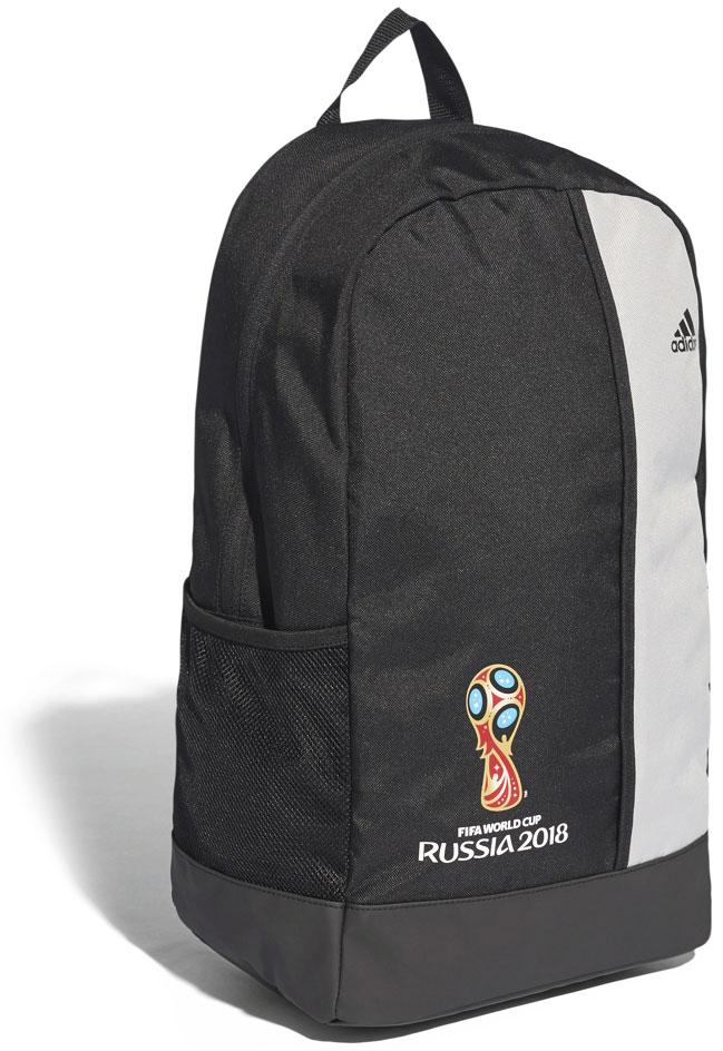 """Почувствуйте энергетику знаменитого чемпионата с рюкзаком Adidas """"OE Backpack"""". Основное отделение дополнено небольшим передним карманом на молнии и боковыми карманами из сетки. Эмблема самого важного футбольного турнира на лицевой стороне. Основное отделение на молнии; передний карман на молнии; боковые карманы из сетки. Мягкие регулируемые лямки. Ручка-петля для переноски. Принт с эмблемой чемпионата мира по футболу 2018 на лицевой стороне. Логотип """"adidas"""" на лицевой стороне. Лицензионная коллекция ФИФА. Размеры: 46 x 28 x 16 см."""