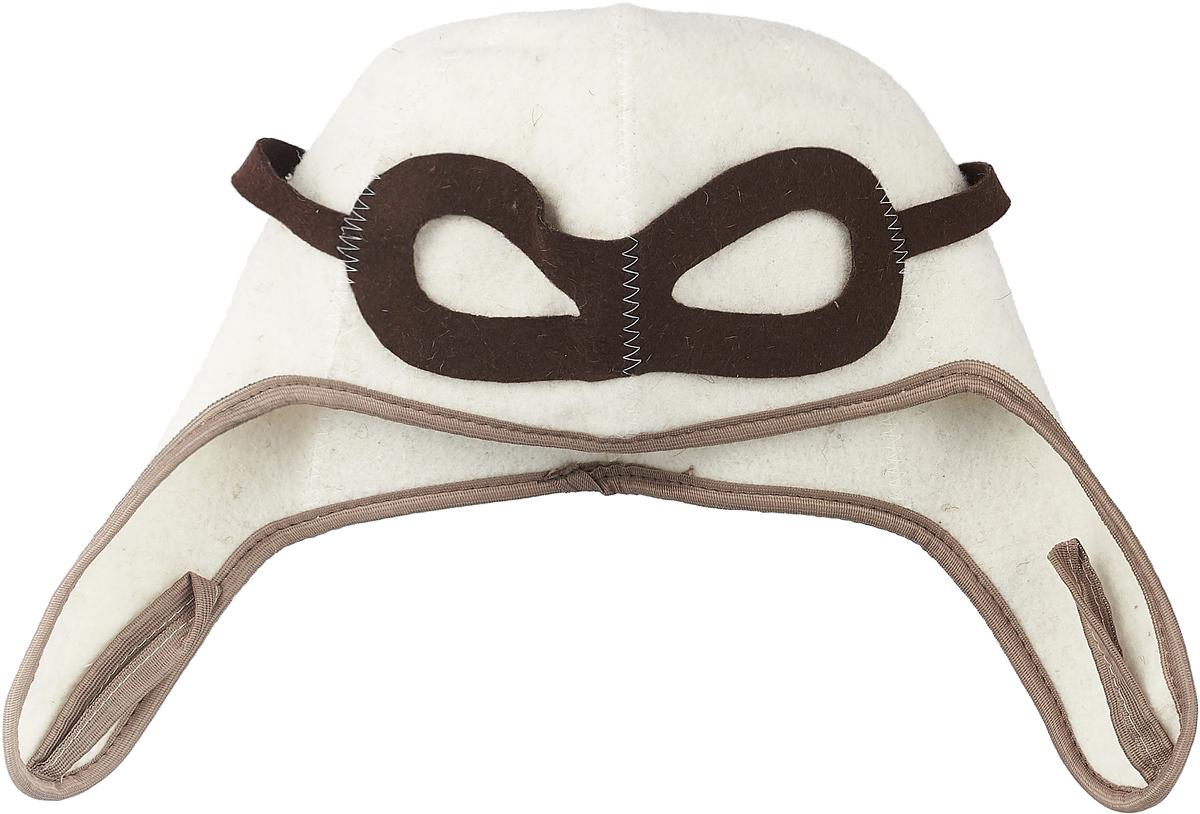 """Шапка Proffi """"Пилот"""" - станет незаменимым аксессуаром для любителей отдыха в  бане и сауне.  Шапка выполнена из войлока и оформлена аппликацией в виде очков пилота. Она  имеет небольшие забавные ушки. Необычный дизайн изделия поможет сделать  ваш отдых более приятным и разнообразным, к тому же шапка защитит вас от  появления головокружения в бани, ваши волосы от сухости и ломкости, а голову  от перегрева.  Обхват головы (по основанию шапки): 62 см.  Высота шапки: 17 см"""