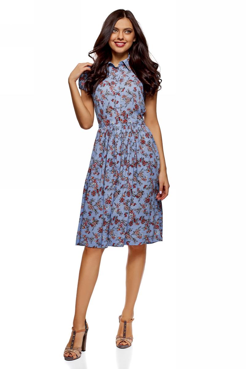 Платье oodji Ultra, цвет: синий, фуксия. 11913026/36215/7547F. Размер 38 (44-170)11913026/36215/7547FСтильное платье oodji Ultra, выгодно подчеркивающее достоинства фигуры, выполнено из качественного материала. Модель средней длины с рукавами-фонариками и отложным воротничком спереди застегивается на пуговицы по всей длине. Пышная расклешенная юбка дополнена по бокам удобными прорезными карманами.