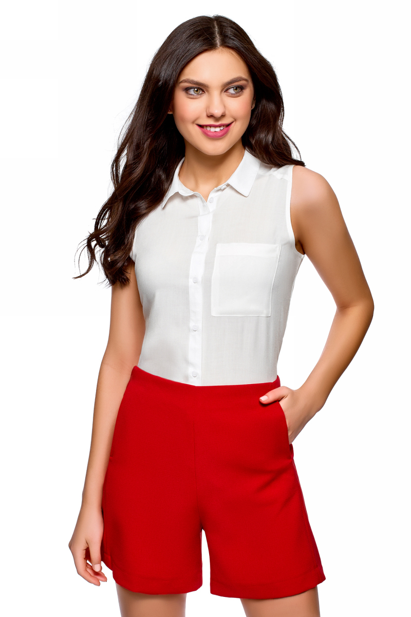 Рубашка женская oodji Ultra, цвет: белый. 14911009B/26346/1200N. Размер 44 (50-170)14911009B/26346/1200NЖенская рубашка oodji выполнена из вискозы. Модель с отложным воротником и без рукавов на груди дополнена накладным карманом.