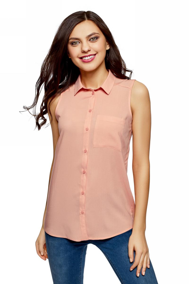 Рубашка женская oodji Ultra, цвет: персиковый. 14911009B/26346/5400N. Размер 44 (50-170)14911009B/26346/5400NЖенская рубашка oodji выполнена из вискозы. Модель с отложным воротником и без рукавов на груди дополнена накладным карманом.