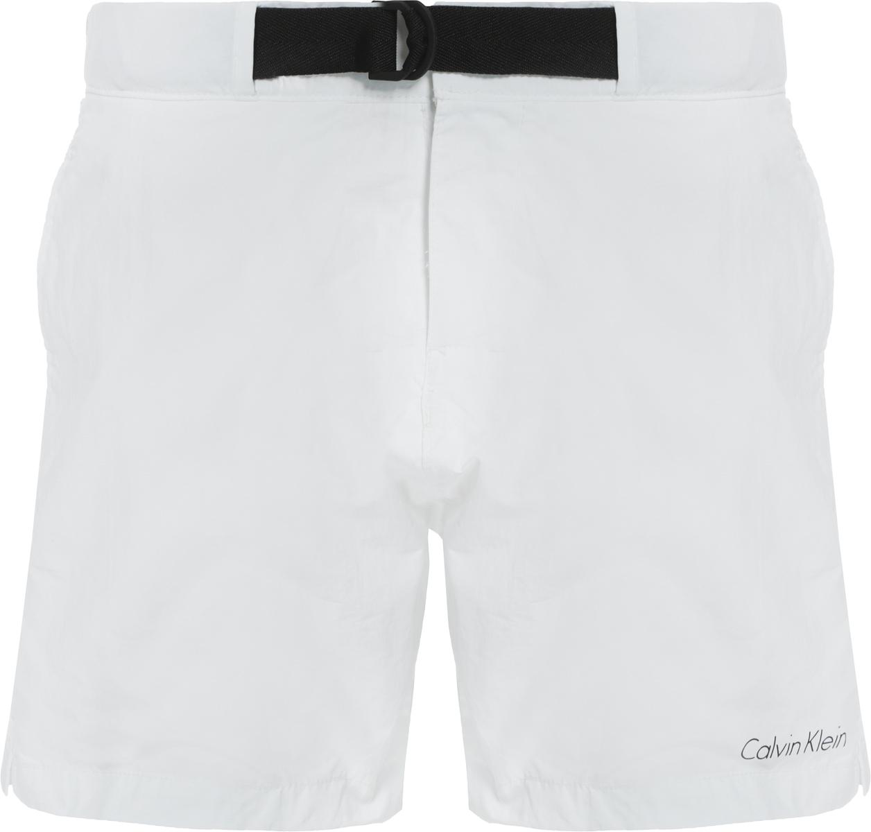 Шорты купальные мужские Calvin Klein Underwear Core Neo, цвет: белый. KM0KM00172. Размер L (50)KM0KM00172Мужские шорты для плавания Calvin Klein Underwear выполнены из мягкого полиамида с сетчатой подкладкой. Удобная посадка и текстильный пояс с фиксатором на талии обеспечат наибольший комфорт. Модель дополнена двумя боковыми карманами и карманом на застежке-молнии на правом бедре, вдоль которого расположен контрастный принт с названием бренда.
