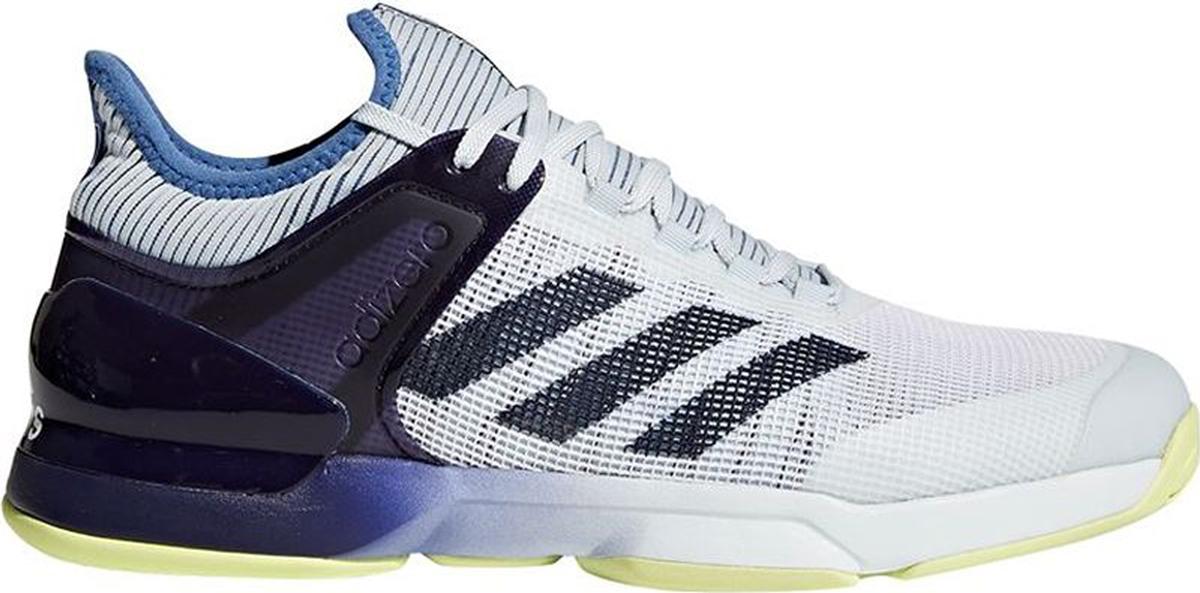 Кроссовки для тенниса мужские Adidas Adizero Ubersonic 2, цвет: фиолетовый, белый. CM7437. Размер 9,5 (42,5)CM7437Покажите свой лучший кросс в теннисных кроссовках Adidas Adizero Ubersonic 2. Созданная для скоростной игры и устойчивости, эта модель с вязаным верхом бережно обхватывает стопу, обеспечивая комфортную и естественную посадку. Функциональные вставки помогают набирать очки: ADITUFF снижает силу трения в области мыска, а ADIPRENE+ увеличивает эффективность отталкивания. Дополнительная поддержка в средней части стопы для повышенной устойчивости во время быстрых маневров.Вязаный верх естественным образом растягивается, адаптируясь под форму стопы, и ,таким образом, снижает риск раздражения кожи и обеспечивает комфортную посадку; крупная сетка обеспечивает превосходную устойчивость и максимальное охлаждение.Износостойкая вставка ADITUFF в передней и средней части кроссовка защищает стопу от пробуксовки и подворачивания во время подач, ударов с лета и резких боковых движений.Вставка ADIPRENE+ в передней части стопы увеличивает силу и эффективность отталкивания; бесшовная конструкция подкладки плотно облегает стопу для комфортной посадки.3D TORSION обеспечивает адаптивную поддержку в средней части стопы; плетеная вставка в средней части стопы для максимальной поддержки и устойчивости во время резкой смены движений.Конструкция SPRINTFRAME обеспечивает идеальное соотношение легкости и устойчивости; вставка ADIPRENE для превосходной амортизации ударных нагрузок.Легкая, исключительно износостойкая подошва ADIWEAR 6 усилена сеткой и подходит для любого типа поверхности.
