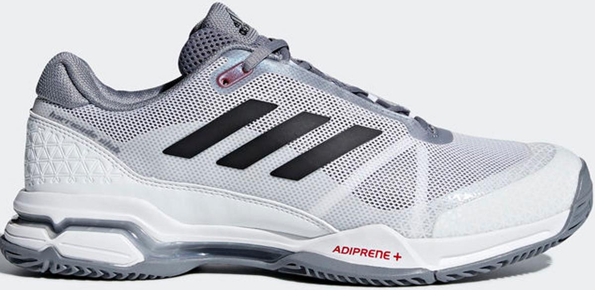 Кроссовки для тенниса мужские Adidas Barricade Club, цвет: серый. CM7782. Размер 10,5 (44)CM7782Контролируй ход игры и побеждай в каждом сете. Эти мужские теннисные кроссовки Adidas Barricade Club с амортизацией boost возвращают энергию каждого шага и обеспечивают устойчивость на любой поверхности даже на высоких скоростях. Бесшовный вязаный верх плотно обхватывает ногу, обеспечивая надежную посадку. Вязаный верх естественным образом растягивается, адаптируясь под форму стопы, и таким образом снижает риск раздражения кожи и обеспечивает комфортную посадку; бесшовная конструкция подкладки плотно облегает стопу для комфортной посадки. Износостойкая вставка ADITUFF в передней и средней части кроссовка защищает стопу от пробуксовки и подворачивания во время подач, ударов с лета и резких боковых движений. Гибкий мысок позволяет пальцам двигаться естественно. Каркас BARRICADE поддерживает и стабилизирует среднюю часть стопы во время динамичных маневров на корте. Анатомическая конструкция GEOFIT для комфорта; слегка расширенная передняя часть. Исключительно износостойкая подошва ADIWEAR.