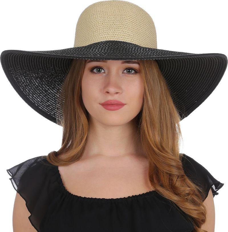 Соломенная шляпа женская Fabretti, цвет: черный. K5. Размер 56/59K5-2/1 black/beigeИзысканная женская широкополая шляпа от итальянского бренда Fabretti выполнена из целлюлозного волокна, которое прекрасно держит форму и позволяет коже головы дышать. Широкие поля прекрасно подчеркнут контуры вашего изящного лица, а также защитят от лучей палящего солнца. Модель впишется в любой цветовой ансамбль, поэтому аксессуар не только защитит от жары и летнего зноя, но и сделает любой пляжный образ более стильным и выразительным. Лаконичный дизайн и минимум лишних деталей с легкостью подчеркнут ваш неповторимый вкус. Размер шляпы регулируется с помощью внутренней утягивающей ленты, что позволит вам не бояться морского бриза или легкого ветра.