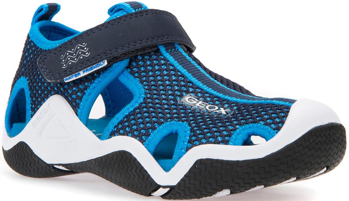 Сандалии для мальчика Geox, цвет: темно-синий, лазурный. J5230C01415C4231. Размер 30J5230C01415C4231Сандалии для мальчика от Geox выполнены из материалов, которые не боятся воды, быстро сохнут, являются антибактериальными и долговечными, снабжены защитным усилением на носке и на пятке. Перфорированная подошва (патент Geox) обеспечивает максимальную воздухопроницаемость и комфорт. Подкладка из микросетки повышает воздухопроницаемость. Дышащая стелька из лайкры обеспечивает максимальный комфорт. Подошва из термопластичной резины отличается прочностью, сцеплением и гибкостью.