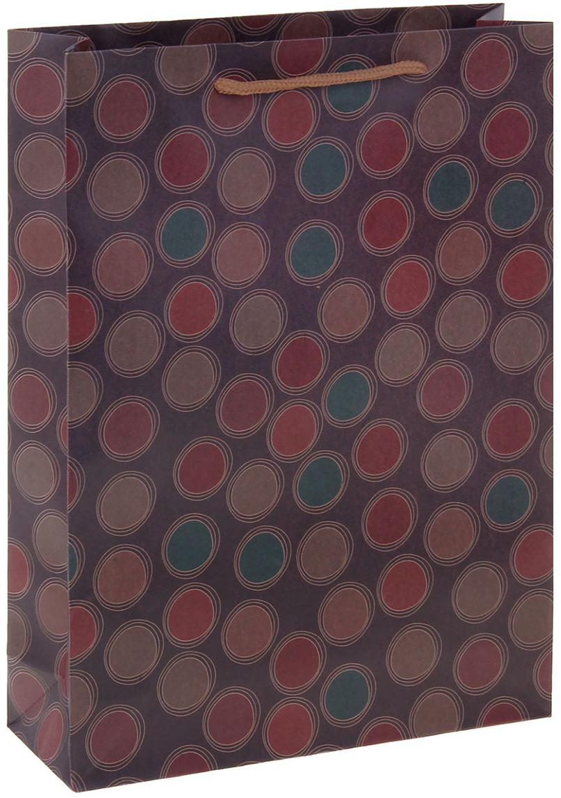 Пакет подарочный Круги, цвет: фиолетовый, 31 х 9,5 х 42 см. 12551261255126Любой подарок начинается с упаковки. Что может быть трогательнее и волшебнее, чем ритуал разворачивания полученного презента. И именно оригинальная, со вкусом выбранная упаковка выделит ваш подарок из массы других. Она продемонстрирует самые теплые чувства к виновнику торжества и создаст сказочную атмосферу праздника. Пакет-крафт Круги - это то, что вы искали.