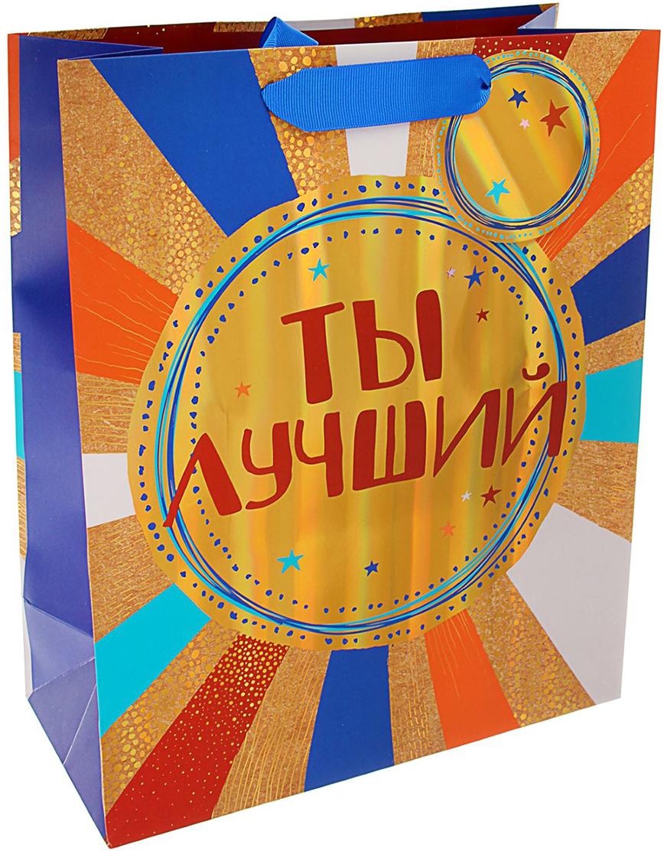 Пакет подарочный Арт и Дизайн Люкс. Ты лучший!, цвет: мультиколор, 32 х 26 х 12 см. 17594091759409Любой подарок начинается с упаковки. Что может быть трогательнее и волшебнее, чем ритуал разворачивания полученного презента. И именно оригинальная, со вкусом выбранная упаковка выделит ваш подарок из массы других. Она продемонстрирует самые теплые чувства к виновнику торжества и создаст сказочную атмосферу праздника. Пакет подарочный Ты лучший! люкс - это то, что вы искали.
