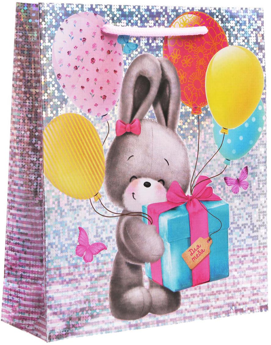 Пакет подарочный Дарите Счастье Долгожданный подарок, голография, цвет: мультиколор, 23 х 8 х 27 см. 18572541857254Любой подарок начинается с упаковки. Что может быть трогательнее и волшебнее, чем ритуал разворачивания полученного презента. И именно оригинальная, со вкусом выбранная упаковка выделит ваш подарок из массы других. Она продемонстрирует самые теплые чувства к виновнику торжества и создаст сказочную атмосферу праздника - это то, что вы искали.