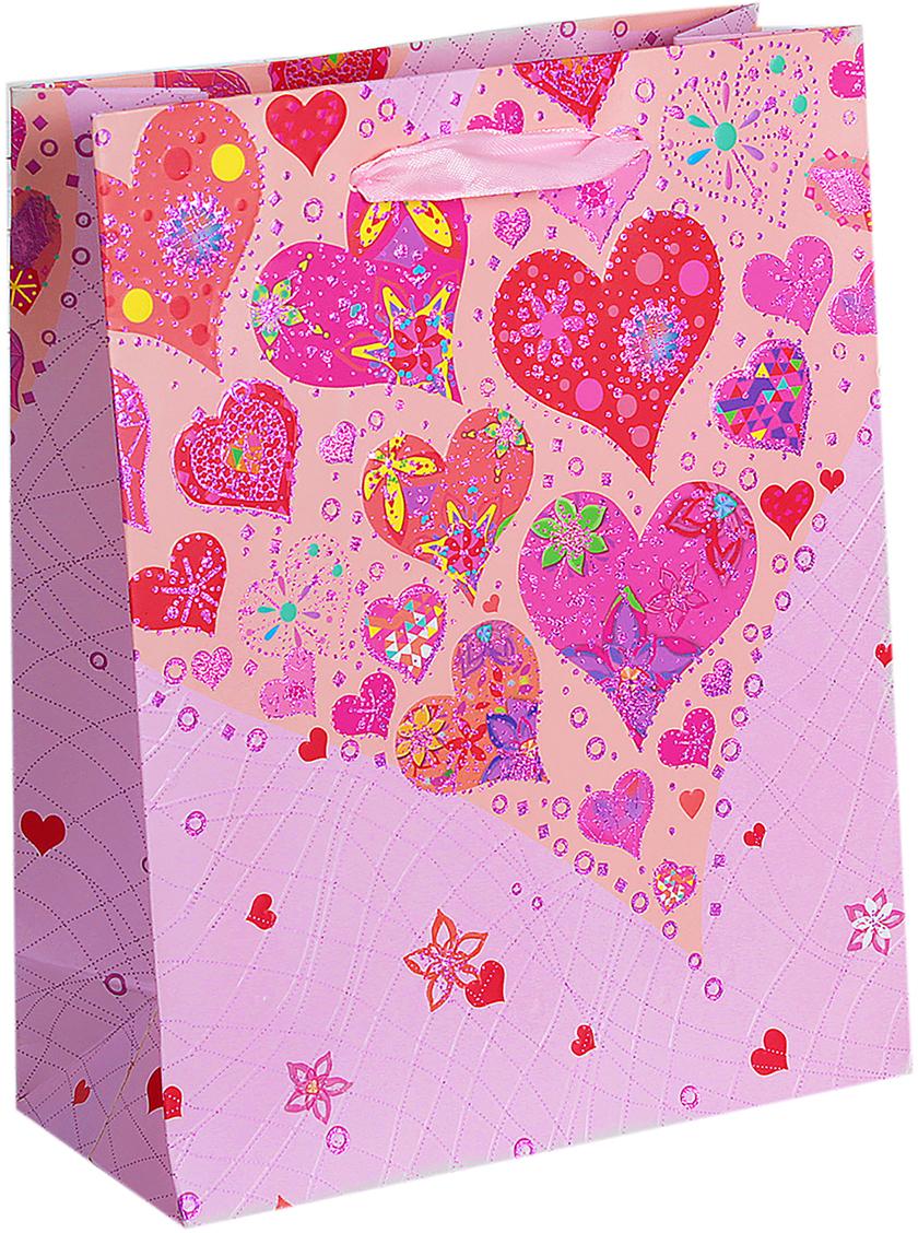 Пакет подарочный Люкс. Сердца, цвет: розовый, 18 х 8 х 23 см. 26543732654373Любой подарок начинается с упаковки. Что может быть трогательнее и волшебнее, чем ритуал разворачивания полученного презента. И именно оригинальная, со вкусом выбранная упаковка выделит ваш подарок из массы других. Она продемонстрирует самые теплые чувства к виновнику торжества и создаст сказочную атмосферу праздника. Пакет подарочный Сердца, люкс - это то, что вы искали.