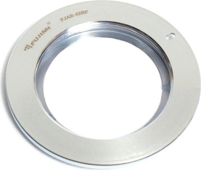 Fujimi FJAR-42NF, Gray Metallic переходник для объектива M42/NikonFJAR-42NFПереходник Fujimi FJAR-42NF предназначен для установки объективов с креплением m42 на фотоаппараты Nikon. Адаптер компенсирует рабочий отрезок, что позволяет фокусироваться на бесконечность. Автофокус доступен не будет. Изготовлен из алюминия с черным матовым покрытием.