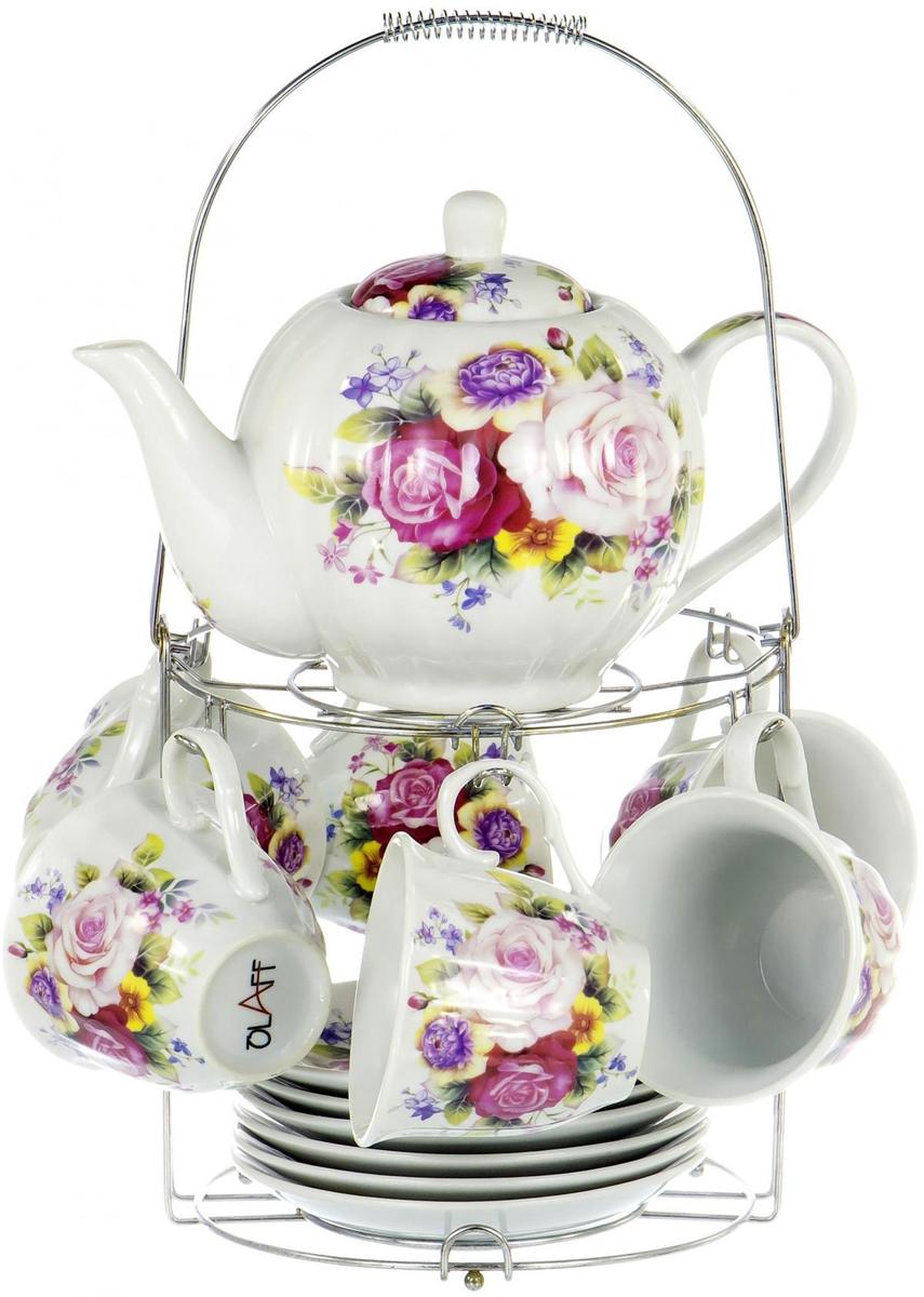"""Чайный набор """"Metal Stand"""" на шесть персон включает в себя шесть чашек 250 мл, шесть блюдец, заварочный чайник 1000 мл и металлическую подставку для удобного хранения, которая позволит сэкономить место на кухне. Посуда выполнена из качественного фарфора и декорирована жизнерадостным цветочным рисунком. Демократичный набор для повседневного использования и семейных посиделок."""