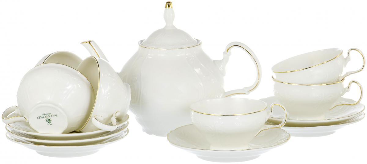 Набор чайный Olaff, 13 предметов. XX-13Y-KTS-CXX-13Y-KTS-CЧайный набор Olaff на 6 персон всем своим видом напоминает о традициях, хороших манерах и изысканной сервировке стола. Белые фарфоровые чашки с тонким золотым ободком имеют приятную винтажную форму и объем 250 мл. Их дополняют блюдца и заварочный чайник объемом 1400 мл.