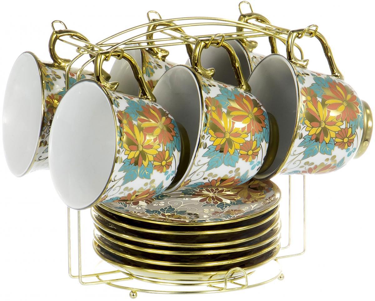 """Чайный набор """"Цветы"""" на шесть персон включает в себя шесть чашек 220 мл, шесть блюдец и металлическую подставку. Посуда выполнена из фарфора и декорирована ярким цветочным орнаментом. Превосходный набор для семейных чаепитий и торжеств."""
