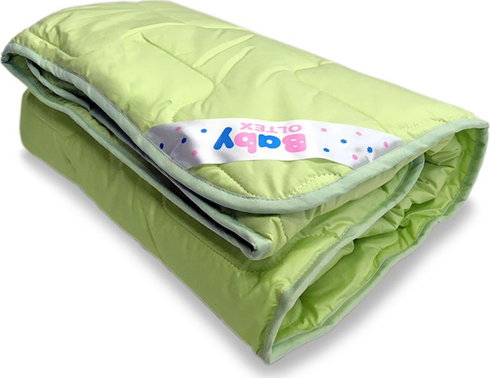 """Одеяло детское """"Ol-tex BABY"""" из коллекции """"Бамбук"""". Замечательное облегченное одеяло с бамбуковым наполнителем. Чехол одеяла выполнен их тика (100% хлопок) фисташкового цвета. Одеяло оформлено фигурной стежкой и окантовано по краю. Стежка равномерно удерживает наполнитель в чехле, а окантовка сохраняет форму изделия.Одеяло обладает прекрасными терморегулирующими свойствами, гиппоаллергенно."""