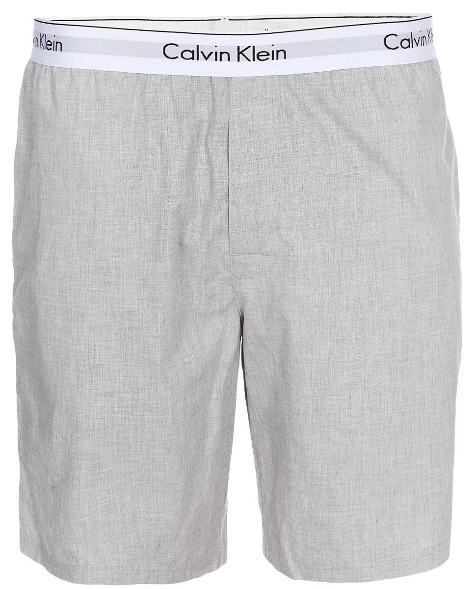 Шорты для дома мужские Calvin Klein Underwear, цвет: серый. NM1523E_080. Размер L (52)NM1523E_080Шорты для дома мужские Calvin Klein Underwear выполнены из натурального хлопка. Удобная посадка и резинка на талии обеспечат наибольший комфорт. Модель оформлена надписью на резинке с названием бренда Calvin Klein.