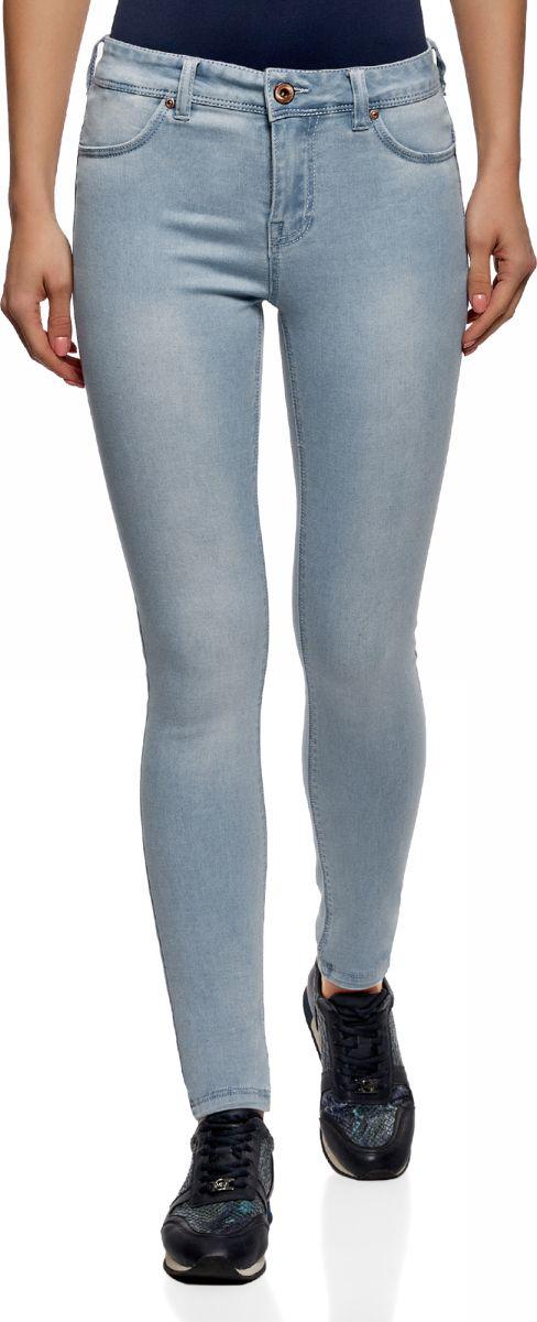 Джинсы женские oodji Ultra, цвет: голубой джинс. 12104075-1/47926/7000W. Размер 28-30 (46-30)12104075-1/47926/7000WДжинсы Skinny от oodji выполнены из эластичного хлопкового денима. Модель облегающего кроя со стандартной посадкой в поясе застегивается на пуговицу, имеет ширинку на молнии и шлевки для ремня. По бокам джинсы дополнены втачными карманами, сзади – накладными карманами.