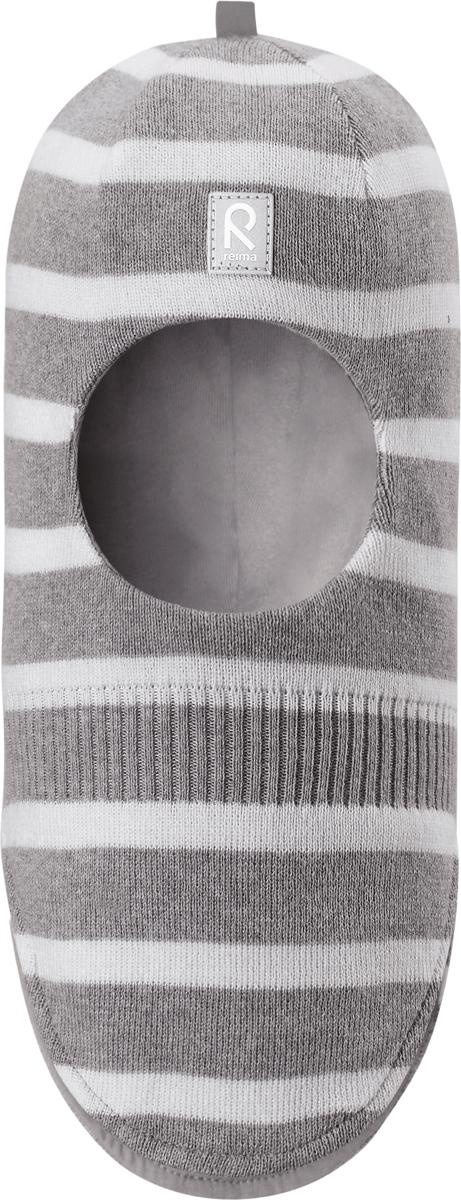 Шапка-шлем детская Reima Honka, цвет: серый. 5184529151. Размер 525184529151Классическая детская шапка-шлем от Reima– незаменимый аксессуар, ведь она согревает не только голову, но и шею. Эта шапка-шлем сшита из эластичного и дышащего хлопкового трикотажа на подкладке из гладкого хлопкового джерси. Новые свежие весенние расцветки! Изделие сертифицировано по стандарту Oeko-Tex.