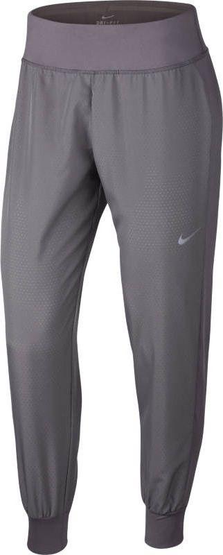 Купить Брюки спортивные женские Nike Dry Essential, цвет: серый. 925811-036. Размер XS (40/42)