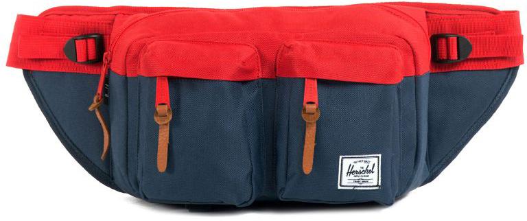 Сумка поясная Herschel Eighteen, цвет: синий, красный, 6 л10018-00018-OSВместительная поясная сумка с двумя внешними карманами. Эта модельотличается своим объёмом, за счёт которого вы всегда сможете взять собойчуть больше нужных вещей. Удобный поясной ремень позволяет носить сумкутакже через плечо, что несомненно оценят, например, любителивелосипедных прогулок. Особенности:Расширяемое основноеотделение на молнии.2 внешних кармана на молнии. Регулируемыйремень с пряжкой.Фирменная полосатая подкладка.Молнии сдеталями из кожи.Ярлычок с логотипом Herschel.Длина ремня 90 см. Объем: 6 л.Материал: 100% полиэстер.