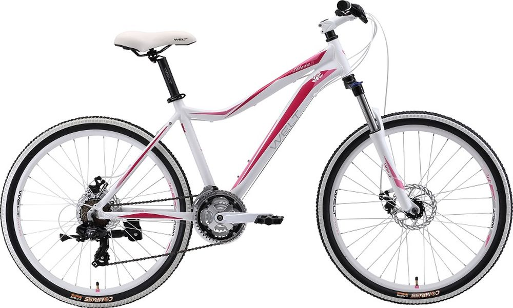 Велосипед женский Welt 2018 Edelweiss 1.0 matt, цвет: белый, красный, рама M, колесо 269333725308351Классический горный женский велосипед Welt Edelweiss 1.0 (2018) года, созданный для активных занятий фитнесом или частых прогулок с друзьями. Отличный вариант для леди, ищущих надежный и легкий велосипед для неторопливых прогулок по городским улочкам и паркам. Отличительной чертой данного велосипеда является яркий дизайн, получившийся благодаря белым элементам и в сочетании сцветом рамы. Welt Edelweiss 1.0 получился легким и прочным - это стало доступным благодаря использованию алюминиевого сплава в конструкции рамы. Благодаря амортизационной вилке Hagen MRK преодоление препятствий не составит для вас труда. Особенности и технологии: - Ободные тормоза V-brake,помогут быстро и плавно остановить велосипед в непредсказуемых ситуациях. - Модель оснащена подножкой. - Для катания по городу имеется функция блокировки амортизации вилки, что поможет сэкономить силы при движении по ровному асфальту. -технология #SPECIAL_TEEN_SERIE# - технология #EASY_FITNESS_GEOMETRY# Технические характеристики: Рама: Alloy 6061 Размер рамы: S, M Диаметр колес: 26 Количество скоростей: 21 Тип вилки: амортизационная Вилка: Hagen MRK 100mm MLO Передний переключатель: #Shimano# TZ-30 Задний переключатель: Shimano TY-300 Шифтеры : Shimano EF-500 3x7 Тип тормозов: #V_brake# Тормоза: Alloy YX-122 Система: steel 42/34/24 Кассета: Shimano TZ21 14-28T Тип рулевой колонки: 1-1/8 безрезьбовая Покрышки: Compass 26 x2,1