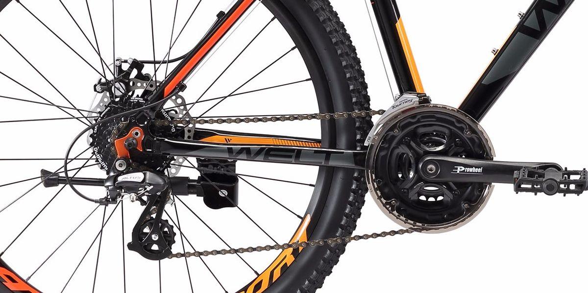 """Welt Ridge 2.0 D 29er - это высококачественных горный найнер для амбициозных райдеров. Этот велосипед поможет вам полностью раскрыть свой потенциал велогонщика. Велосипед предназначен как для неторопливых прогулок по лесным тропам, так и для спортивного катания в дисциплине кросс-кантри. Благодаря современной геометрии и большим колесам вы сможете использовать Welt Ridge 2.0 D 29er на все 100%.Привод работает без замедлений/шумов даже под серьезными нагрузками. Велосипед останавливается предельно быстро и в любых условиях благодаря дисковым тормозам Zoom DB.Предусмотрена возможность регулировки предварительной нагрузки и блокировка хода. Особенности и технологии: - технология #29ER# - технология #DIAMOND_SHAPE_GEOMETRY# - технология #МТВ_SPECIAL_SERIES# - технология #SMOOTH_WELDING_DESIGN# - дисковые тормоза Zoom DB 280 не подведут вас даже в экстремальной ситуации и отлично тормозят независимо от погодных условий. - навесное оборудование любительского уровня #Shimano# Altus порадует вас четкостью работы. - амортизационная вилка с масляной блокировкой хода Suntour XCT HLO поможет сгладить все неровности дорожного полотна.  Технические характеристики: Рама: Alloy 6061 Размер рамы: M, L Диаметр колес: 29"""" Кол-во скоростей: 24 Тип вилки: амортизационная Вилка: #Suntour_XCT_HLO_100mm# Переключатель задний : Shimano TX-50 Переключатель передний: Shimano Altus Шифтеры: Shimano EF-500 3x8 Тип тормозов: дисковые механические Тормоза: Zoom DB 280 Система: Prowheel alloy 42/34/24 Кассета: Shimano HG20 12-28T Тип рулевой колонки: semi-integrated 1- 1/8*44 Покрышки: Radiant 29 x2,2"""