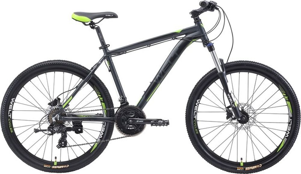 Велосипед горный Welt 2018 Ridge 1.0 HD matt, цвет: серый, зеленый, рама M, колесо 269333725308641Сенсационная модель, ломающая стереотипы! Классическая универсальная модель начального уровня с дисковыми гидравлическими тормозами. С одной стороны, это классическая универсальная модель начального уровня с 26 дюймовыми колесами на двойных ободах и 21-й скоростной трансмиссией Shimano серии TX для рядовых пользователей, редко использующих велосипед ежедневно. C другой стороны, данная модель оснащена дисковыми механическими тормозами Shimano, которыми обычно комплектуются велосипеды спортивного уровня, в разы дороже, что делает ее на порядок безопаснее, качественнее и не имеющей аналогов на российском рынке при сравнении с конкурентами по цене. Вторым уникальным преимуществом является амортизационная вилка с ходом 100 мм, цельнолитой алюминиевой короной и функцией блокировки хода. Также необходимо отметить сложные сечения профилей труб и технологии обработки алюминиевого сплава рамы. Особенности и технологии: - технология #DIAMOND_SHAPE_GEOMETRY# - технология #МТВ_SPECIAL_SERIES# - технология #SMOOTH_WELDING_DESIGN# - технология #DOUBLE_BUTTED# - технология #SHARPEDGETUBING# - дисковая гидравлика #Shimano#, делает модель в разы безопаснее и не имеет аналогов - модель оснащена подножкой в базе - покрышки повышенной проходимости 26х2.35 - новое анатомическое седло - цельнолитая контрукция вилки Hagen, механическая блокировка, ход 100мм  Технические характеристики: Рама: Alloy 6061 Размер рамы: S,M,L Диаметр колес: 26 Кол-во скоростей: 21 Тип вилки: амортизационная Вилка: Hagen MRK 100mm MLO Переключатель задний : Shimano TY-300 Переключатель передний: Shimano TZ-30 Шифтеры: Shimano Altus 3x7 скоростей Тип тормозов: дисковые гидравлические Тормоза: Shimano M-315 Система: Prowheel alloy 42/34/24 Кассета: Shimano TZ21 14-28T Тип рулевой колонки: 1-1/8 безрезьбовая Покрышки: Radiant 26 x2,35