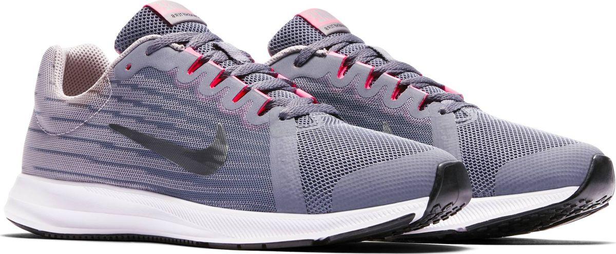 Кроссовки для девочки Nike Downshifter 8, цвет: серый. 922855-002. Размер 4,5Y (35,5)922855-002Беговые кроссовки для девочек Nike Downshifter 8 в минималистичном стиле выполнены из легкой однослойной сетки с обновленной амортизирующей стелькой — еще более мягкой, чем в предыдущих версиях. В сочетании с эластичными желобками и резиновой подметкой это обеспечивает плавную амортизацию. Верх из легкой сетки обеспечивает вентиляцию и комфорт. Обновленная подошва для мягкой и упругой амортизации. Полноразмерная резиновая подметка обеспечивает прочность и сцепление с любой поверхностью.