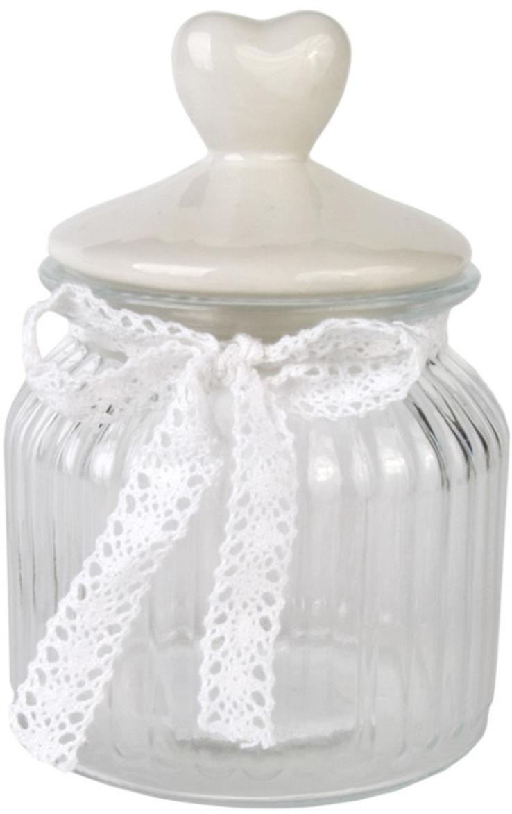 """Банка для сыпучих продуктов Magic Home """"Белое сердечко"""" объемом 600 мл изготовлена из стекла, дополнена декоративной крышкой из керамики. Изделие имеет прозрачные стенки, поэтому всегда видно, что именно находится внутри. Банка удобна для хранения круп, сахара, специй, кофе или чая. Она стильно дополнит интерьер и поможет эффективно организовать пространство на кухне."""