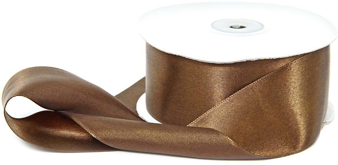 Лента декоративная Veld-Co, атласная, цвет: шоколадный, 3,8 х 30 см48774Декоративная лента Veld-Co предназначена для оформления подарочных коробок, пакетов. Кроме того, декоративная лента с успехом применяется для художественного оформления витрин, праздничногооформления помещений, изготовления искусственных цветов.Декоративная лента украсит интерьер вашего дома к любым праздникам.Ширина ленты: 38 мм.