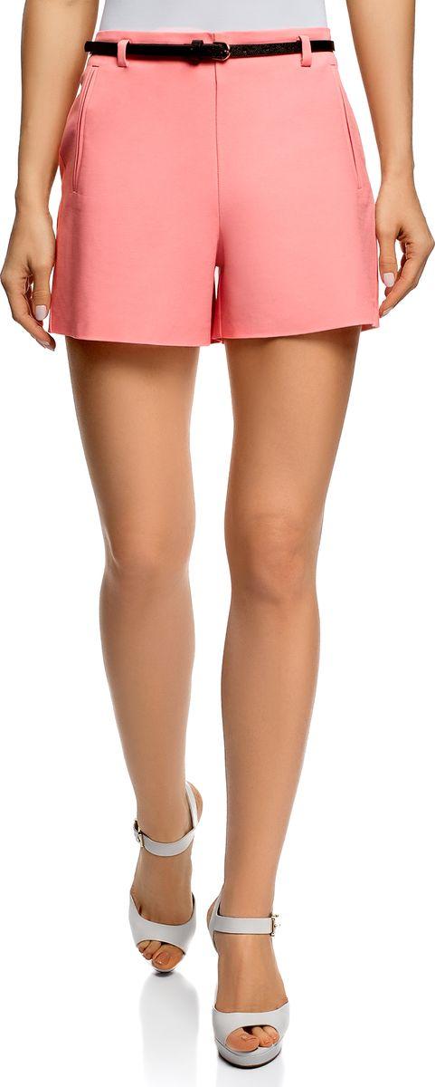 Шорты женские oodji Ultra, цвет: розовый. 11800038/48229/4100N. Размер 44 (50-170)11800038/48229/4100NЭлегантные шорты от oodji прямого силуэта с узким ремнем в комплекте. Спереди два врезных кармана. Для удобства на шортах есть шлевки для ремня. Хлопковая ткань с небольшим добавлением эластана приятна на ощупь, отлично держит форму, дышит и не раздражает кожу. В таких шортах вам будет комфортно даже в жаркую погоду. Короткие шорты прямого силуэта отлично сидят на любой фигуре, визуально стройнят ноги, а узкий ремешок акцентирует внимание на линии талии.Хлопковые шорты с ремнем прекрасно подойдут для повседневных выходов. В них можно отправиться на прогулку, сходить на свидание, встретиться с друзьями или пойти по делам. К этим шортам легко подобрать самые разные по стилю вещи. В сочетании с футболкой и сандалиями получится универсальный наряд для прогулок. А с блузкой и жакетом – более сдержанный и элегантный наряд для важных встреч. В выборе обуви вы практически не ограничены – к таким шортам подойдут эффектные босоножки на высоком каблуке, сандалии, пляжные тапки или слипоны. Красивые шорты для тех, кто любит комфортные и стильные наряды!