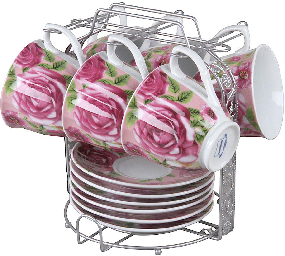 Чайный набор Rosenberg RPO-115018-13 изготовлен из фарфора и дополнен дизайнерским рисунком.  Посуда из этого материала позволяет максимально сохранить полезные свойства и вкусовые качества воды.  Заварите крепкий, ароматный чай или кофе в представленном наборе, и вы получите заряд бодрости, позитива и энергии на весь день! Классическая форма и насыщенная цветовая гамма изделий позволят наслаждаться любимым напитком в атмосфере еще большей гармонии и эмоциональной наполненности.  Оцените преимущества чайного набора: Выполнен из качественного материала.  Украшен цветочным узором, поэтому не останется незамеченным.  Является прекрасным подарком для ваших родных и близких.  В комплект входят 13 предметов, включая подставку.  О бренде Rosenberg Огромный ассортимент продукции, качественные материалы и ценовая доступность это основополагающие принципы успеха данного торгового знака на Российском рынке.  По данным начала 2009 года именно Rosenberg являлся самым динамично развивающимся брендом, который всего за 4 года вывел в продажу более 2,5 тысяч наименований товаров.