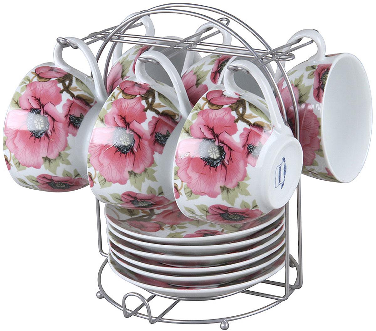 Чайный набор Rosenberg RPO-115019-13 изготовлен из фарфора и дополнен дизайнерским рисунком.  Посуда из этого материала позволяет максимально сохранить полезные свойства и вкусовые качества воды.  Заварите крепкий, ароматный чай или кофе в представленном наборе, и вы получите заряд бодрости, позитива и энергии на весь день! Классическая форма и насыщенная цветовая гамма изделий позволят наслаждаться любимым напитком в атмосфере еще большей гармонии и эмоциональной наполненности.  Оцените преимущества чайного набора: Выполнен из качественного материала.  Украшен цветочным узором, поэтому не останется незамеченным.  Является прекрасным подарком для ваших родных и близких.  В комплект входят 13 предметов, включая подставку.  О бренде Rosenberg Огромный ассортимент продукции, качественные материалы и ценовая доступность это основополагающие принципы успеха данного торгового знака на Российском рынке.  По данным начала 2009 года именно Rosenberg являлся самым динамично развивающимся брендом, который всего за 4 года вывел в продажу более 2,5 тысяч наименований товаров.