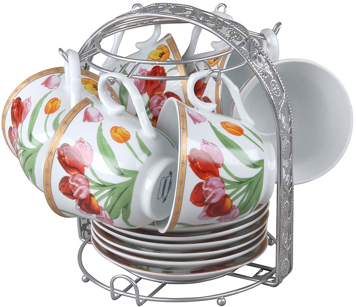 Чайный набор Rosenberg RPO-115020-13 изготовлен из фарфора и дополнен дизайнерским рисунком.  Посуда из этого материала позволяет максимально сохранить полезные свойства и вкусовые качества воды.  Заварите крепкий, ароматный чай или кофе в представленном наборе, и вы получите заряд бодрости, позитива и энергии на весь день! Классическая форма и насыщенная цветовая гамма изделий позволят наслаждаться любимым напитком в атмосфере еще большей гармонии и эмоциональной наполненности.  Оцените преимущества чайного набора: Выполнен из качественного материала.  Украшен цветочным узором, поэтому не останется незамеченным.  Является прекрасным подарком для ваших родных и близких.  В комплект входят 13 предметов, включая подставку.  О бренде Rosenberg Огромный ассортимент продукции, качественные материалы и ценовая доступность это основополагающие принципы успеха данного торгового знака на Российском рынке.  По данным начала 2009 года именно Rosenberg являлся самым динамично развивающимся брендом, который всего за 4 года вывел в продажу более 2,5 тысяч наименований товаров.