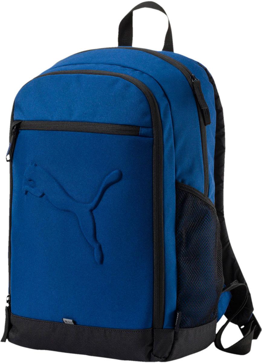 Рюкзак мужской Puma Buzz Backpack, цвет: синий, 26 л. 0735812607358126Удобный и вместительный рюкзак имеет главное отделение на молнии, открывающейся с двух сторон, переднее отделение на молнии, карман на молнии спереди, отделение для ноутбука с подложкой из эластичного материала внутри главного отделения, два накладных кармана внутри переднего отделения, карманы из сетчатого материала по бокам, функциональную подкладку из полиэстера с изнанкой из полиуретана и ручку из лямочной ленты. Обращенная к спине часть рюкзака отстрочена и имеет мягкую подложку. Все металлические язычки застежек-молний снабжены дополнительными язычками из плотной тесьмы. Закругленные лямки регулируемой длины снабжены петлями из светоотражающего материала с символикой Puma. Также символика Puma представлена на лямочной ленте, которой отделан передний карман рюкзака, на тканевых ярлыках по бокам и в виде крупного выпуклого логотипа Puma спереди. Кроме того, перед рюкзака отделан лямочной лентой Durabase из светоотражающего материала.