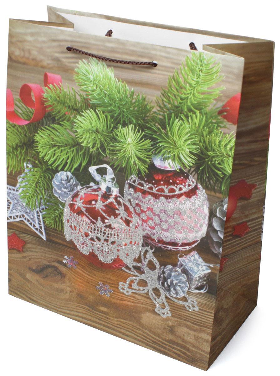 """Пакет подарочный МегаМАГ """"Новый год"""", ламинированный, 41 х 56 х 24 см. 919 XXL.Подарочный пакет, изготовленный из плотной ламинированной бумаги, станет незаменимым дополнением к выбранному подарку. Для удобной переноски на пакете имеются ручки-шнурки.Подарок, преподнесенный в оригинальной упаковке, всегда будет самым эффектным и запоминающимся. Окружите близких людей вниманием и заботой, вручив презент в нарядном, праздничном оформлении."""
