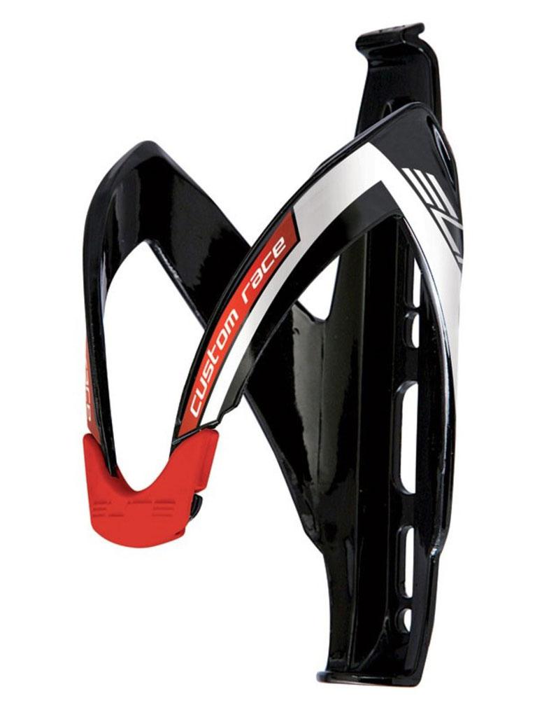 """Флягодержатель Elite """"Custom Race"""" является эталоном среди гоночных флягодержателей и используется командами Про-Тура. Имеет конструкцию, способную адаптироваться под размер и форму фляги.  Отличительные особенности: - Проверен профессиональными гонщиками и командами - Выполнен из армированного полиамида (FRP) с отделкой из окрашенного стекловолокна  - Вставка из эластомера адаптируется к форме и размеру фляги, а так же гасит вибрации - Прочная, гибкая и стильная конструкция"""