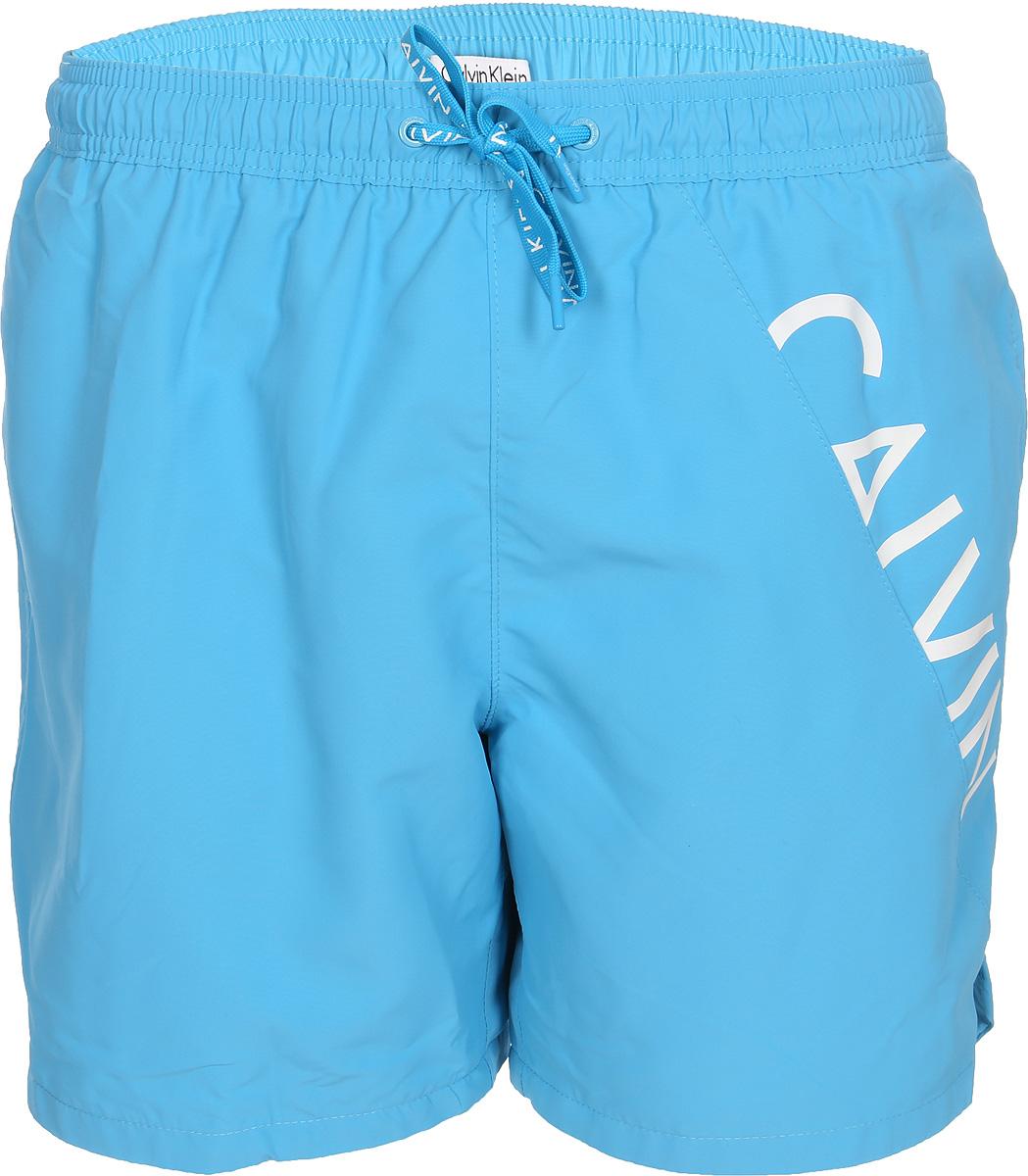 Шорты для плавания мужские Calvin Klein Underwear, цвет: голубой. KM0KM00168_409. Размер S (48) шорты женские calvin klein jeans цвет светло голубой j20j204963 размер 26 38 40