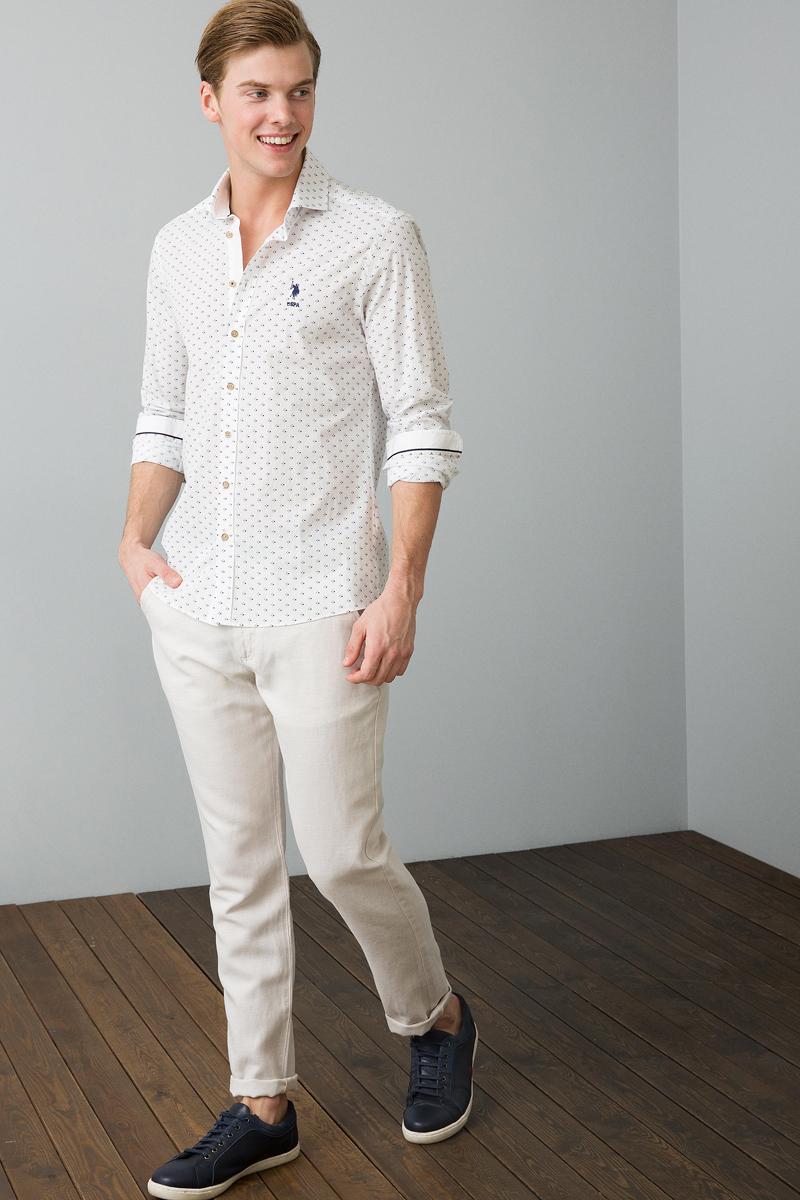 Рубашка мужская U.S. Polo Assn., цвет: белый. G081SZ0040FRANCO_VR027. Размер S (46)G081SZ0040FRANCO_VR027Приталенная мужская рубашка, выполненная из 100% хлопка, подчеркнет ваш уникальный стиль и поможет создать оригинальный образ. Такой материал великолепно пропускает воздух, обеспечивая необходимую вентиляцию, а также обладает высокой гигроскопичностью. Рубашка с длинными рукавами и отложным воротником застегивается на пуговицы спереди. Манжеты рукавов также застегиваются на пуговицы.