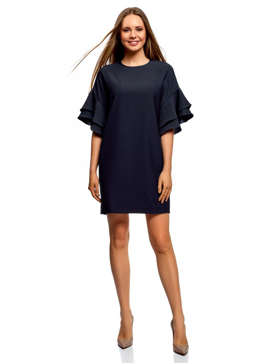Платье oodji Ultra, цвет: темно-синий. 12C00005/42710/7900N. Размер 34 (40-164)12C00005/42710/7900NКороткое платье с цельнокроеным рукавом и воланами. Свободная модель силуэта баллон чуть заужена книзу. Вырез под горло оформлен на спинке вырезом-капелькой и застежкой на пуговицу. Короткие цельнокроеные рукава украшены эффектными воланами в два ряда.Легкая ткань приятна для тела, отлично держит форму и практически не мнется. Модель подойдет для фигур разных типов.Свободное платье с воланами на рукавах – это и прекрасный вариант для отдыха или вечера в кругу друзей, и безупречный наряд для торжественного случая. К нему легко подобрать нитку жемчуга или изящную брошь. Из обуви можно выбрать лодочки, туфли на платформе или босоножки на каблуке-рюмочке. Минодьер или сумочка с фермуаром поставит стильную точку в вашем наряде.В этом очаровательном платье с воланами вы всегда будете в центре внимания!