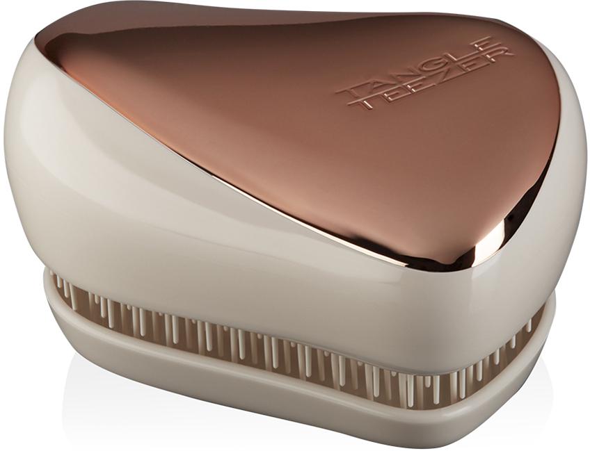 Tangle Teezer Расческа Compact Styler Rose Gold Luxe2124Расческа Tangle Teezer Compact Styler Rose Gold будет с вами, где бы вы ни находились! Благодаря компактной форме эта расческа поместится в любую сумочку, а плотно прилегающая крышка защитит расческу от пыли и повреждений. Эргономичная форма позволяет легко расчесывать как сухие, так и влажные волосы. Благодаря уникальному строению зубчиков, расческа мягко скользит по волосам, не повреждая и не травмируя их. После использования расчески волосы приобретают здоровый вид и блеск, становясь гладкими и шелковистыми.