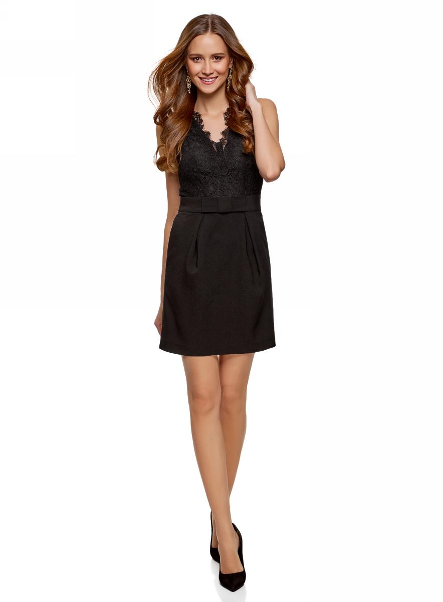 Платье женское oodji Ultra, цвет: черный. 12C13005/42354/2900N. Размер 36 (42-170)12C13005/42354/2900NКороткое платье с кружевом и бантом на поясе. Модель отрезная в талии. Кружевной лиф делает ее необыкновенно нарядной. Глубокий V-образный вырез обработан фигурным кружевом. Спинка из ажурного полотна сшита без подкладки. Талию подчеркивает широкий пояс с бантом, юбка-тюльпан открывает колени. Плотная ткань формирует силуэт, не подвержена усадке, почти не мнется. Платье точно садится по фигуре и акцентирует внимание на ее изгибах. Очаровательное платье с кружевом идеально подходит для торжественных событий, романтических встреч и случаев, когда необходимо произвести особое впечатление на окружающих. Туфли-лодочки, обувь на шпильке или изящные балетки дополнят образ. Шею можно украсить ниткой жемчуга, а руки – браслетами. Клатч или минодьер завершат изысканный лук. В этом кружевном платье вы неизменно будете в центре внимания!