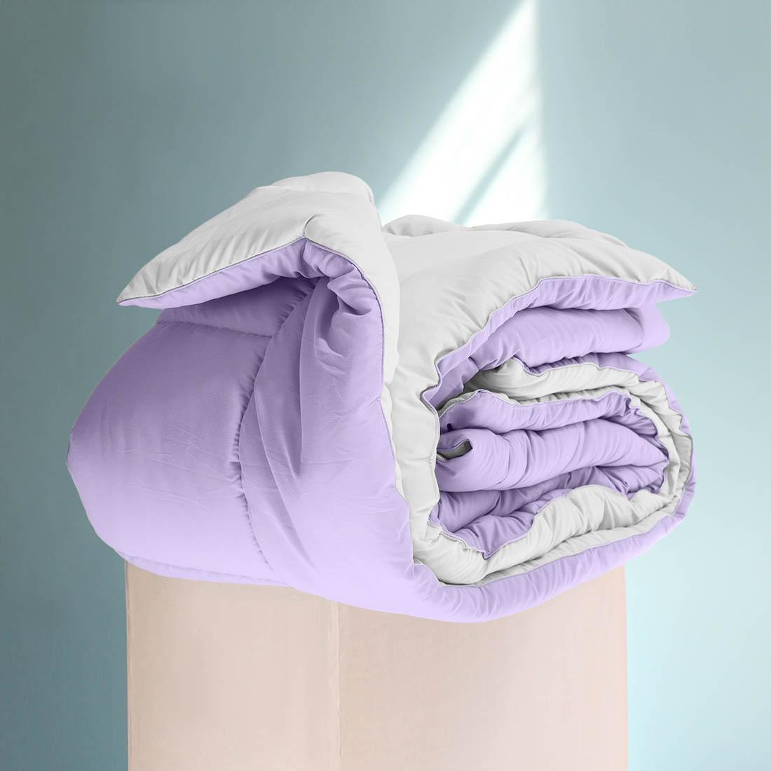 Одеяло Sleep iX, наполнитель: силиконизированное волокно, цвет: фиолетовый, белый, 155 х 215 см. pva320011pva320011Особая технология позволяет использовать это одеяло без пододеяльника, не опасаясь износа.Материал чехла MicroSkin - это гладкая и шелковистая ткань с легким блеском, по своему виду не уступает натуральному хлопку. Хорошо сохраняет тепло, очень приятна на ощупь, прочна и устойчива к стирке.Силиконизированное волокно делают из тонких волокон полиэфира, обработанных силиконом. Одеяло с таким наполнителем отлично сохраняет тепло, создавая максимальный комфорт и уют. Силиконизированное волокно отлично держит форму, не сбиваясь в комки. На ощупь наполнитель похож на пух, поэтому производители часто называют его искусственным пухом. Одеяло с полиэфирным наполнителем отлично подойдёт людям, страдающим аллергией, так как не впитывает запахи и отталкивает пыль. Кант делают из атласа или вискозы, он помогает изделию держать форму в течение многих лет. Кантик есть на многих объемных изделиях из текстиля, иногда его могут дополнительно прострочить по периметру или сделать широким.