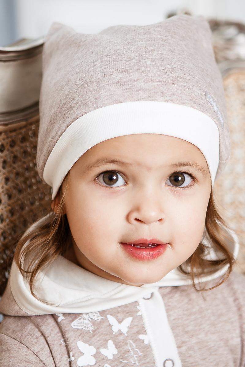 Шапка для девочки Lucky Child Дюймовочка, цвет: бежевый. 37-9/беж. Размер 3837-9/бежМягкая хлопковая шапочка из коллекции Дюймовочка выполнена в спокойной цветовой гамме, что делает её универсальным дополнением любого наряда. В такой шапочке не страшны никакие сквозняки, а в забавные ушки традиционно влюбляются все малыши.