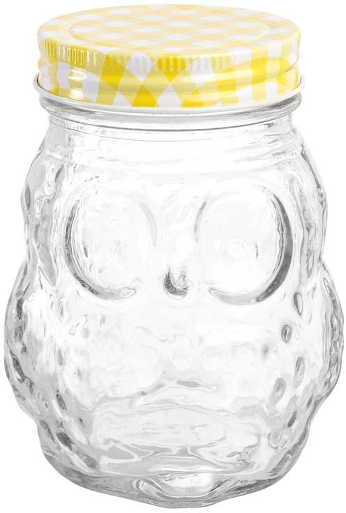 Банка для хранения Elan Gallery Сова, с крышкой, цвет: прозрачный, желтый, 470 мл300113Банка для хранения объемом 470 мл выполнена из качественного стекла с рельефным рисунком и формой совы станет незаменимым помощником в хранении продуктов! Банка плотно закрывается жестяной крышкой разных цветов, что поможет различить содержимое банок и добавит на вашу кухню цвета и яркости. Банка прекрасно подойдет для хранения специй, чая, кофе и любых других сыпучих продуктов. Также в банке можно хранить варенье, мед, орехи и любые другие продукты. А яркая упаковка делает эту банку прекрасным полезным подарком. В коллекции банок из стекла с жестяными крышками также представлены банки для хранения различных размеров и форм, кружки для коктейлей с трубочками и банки с металлическими защелками - вы сможете эстетично и удобно разместить все необходимое на вашей кухне собрав набор из необходимых вам предметов.