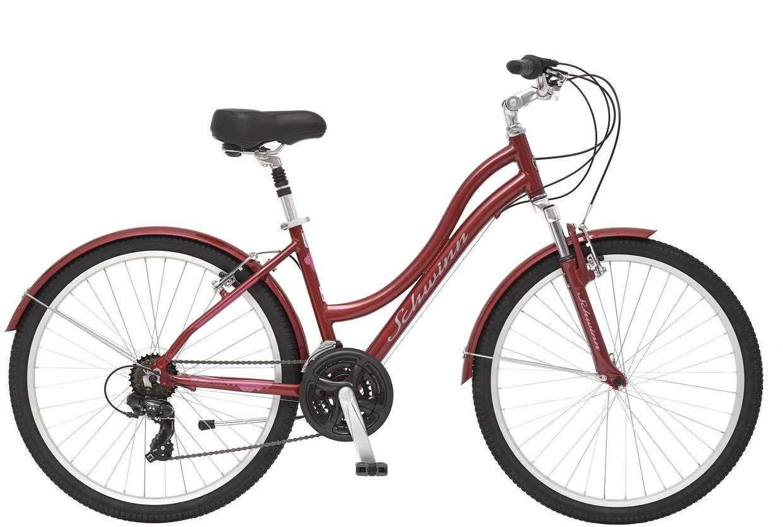 """Велосипед городской Schwinn Suburban Deluxe Women, цвет: красный, колесо 2638675149861Suburban Deluxe Women - невероятно комфортный велосипед для девушек предпочитающих активно проводить свободное время. Не важно, поездка ли это из дома до работы или расслабленное катание в парке, Schwinn Suburban DLX Women сделает эту поездку незабываемой. Широкое мягкое седло в сочетании с амортизационным подседельным штырем, а так же амортизационная вилка делают катание воздушным, как будто парите над землей. Регулируемый по наклону и высоте руль помогает подобрать идеальную для Вас посадку. Переключатели скоростей от знаменитой компании Shimano гарантируют долговечную работу без частых настроек. Полноразмерные крылья и защита передних звезд сохраняют вашу одежду чистой в дождливую погоду. • Рама Schwinn Comfort Alloy • Амортизационная вилка • Переключатели Shimano, грипшифт • 21 скорость • Ободные тормоза • Колеса 26"""" • Полноразмерные крылья • Защита передней звезды • Быстросъемные колеса на эксцентриковых осях"""