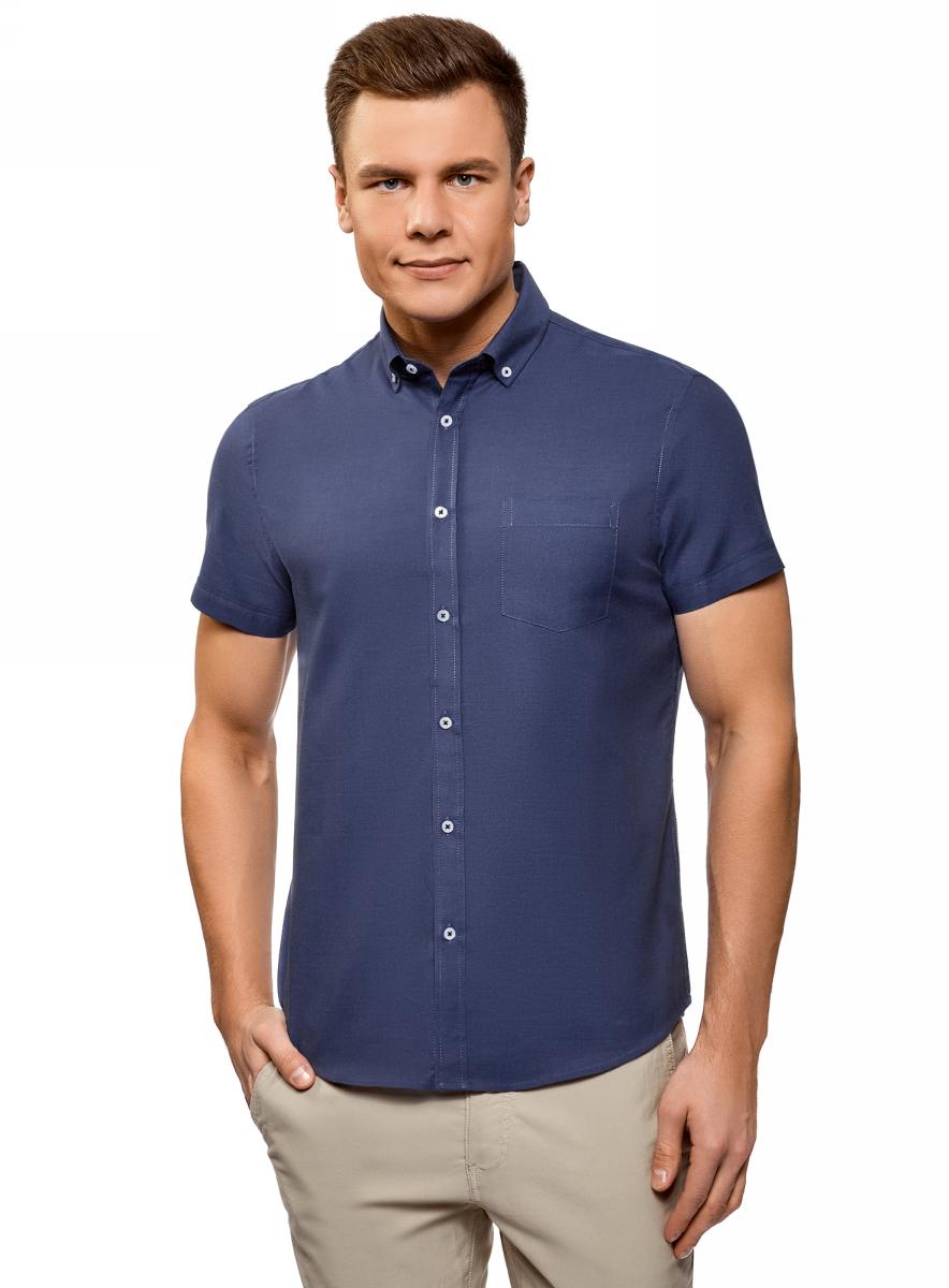 Рубашка мужская oodji Basic, цвет: синий. 3B210007M/34714N/7579O. Размер 40 (48-182)3B210007M/34714N/7579OХлопковая рубашка от oodji с короткими рукавами и воротником баттен-даун. Модель слегка приталенного кроя с закругленным низом и спинкой на кокетке. Короткие рукава с отворотом красиво открывают руки. Классический стояче-отложной воротник на пуговицах. На груди есть нагрудный карман. Благодаря контурным вытачкам на спинке рубашка подчеркивает силуэт. Натуральный хлопок приятен для тела, позволяет коже дышать, поэтому в такой рубашке вы будете чувствовать себя комфортно в любую погоду. Модель прекрасно сидит на любой фигуре.Классическая строгая рубашка – обязательный элемент базового гардероба. Она отлично подходит для деловых костюмов. Ее можно надеть на официальное или торжественное мероприятие, или носить как повседневную офисную вещь. К такому наряду отлично подойдут классические туфли, соответствующие общему стилю. Комплект дополнит стильный галстук или бабочка. Рубашка с закругленным низом и воротником на пуговицах будет уместна и в более непринужденных сочетаниях в стиле Casual. К ней подойдут джинсы, прямые или зауженные брюки, а из обуви – лоферы, броги или мокасины. В этой рубашке вы будете чувствовать себя комфортно в любой ситуации.