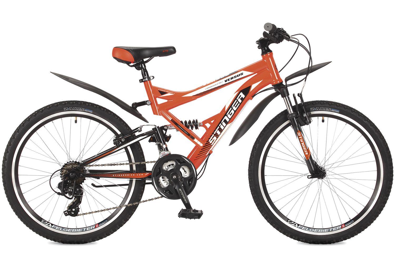 Велосипед горный Stinger Versus, цвет: оранжевый, 24, рама 16,524SFV.VERSUS.16OR7Велосипед Stinger Versus - это подростковый велосипед для активного катания по пересеченной местности. Велосипед оборудован передней амортизационной вилкой, а также задним амортизатором, благодаря чему велосипед имеет повышенную проходимость. Никакие ухабы и сложные подъемы для него не проблема. Переключение скоростей осуществляется удобными курками. Прочная стальная рама Hi-Ten гарантирует высокую надежность и обеспечивает хороший накат. Оборудование Shimano Tourney - переключение передач от мирового лидера компании гарантирует четкую и гладкую работу в любых условиях. Универсальные покрышки Z-Axis для лучшего сцепления на покрышках используется специальный рисунок, создающий условия для хорошей управляемости.