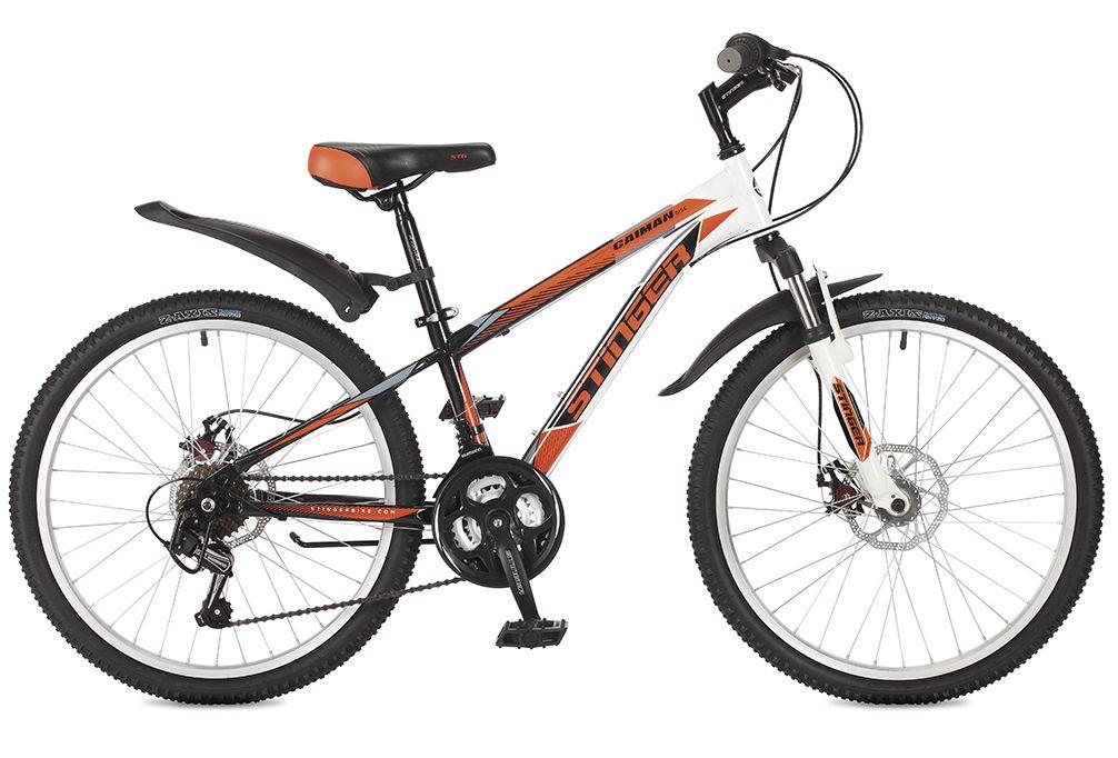 Велосипед горный Stinger Caiman D, цвет: оранжевый, 24, рама 1424SHD.CAIMD.14OR7ВелосипедStinger Caiman D - это простой, надежный и удобный горный велосипед начального уровня, предназначенный для езды по ровной поверхности и легкому бездорожью. Прочная стальная рама Hi-Tensile гарантирует высокую надежность и обеспечивает хороший накат. Амортизационная вилка Stinger с ходом 50 мм - для большего комфорта при езде по неровностям. Для лучшего сцепления на покрышках Z - axis используется специальный рисунок, создающий условия для хорошей управляемости.
