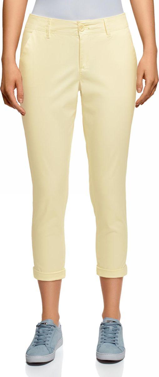 Брюки женские oodji Ultra, цвет: светло-желтый. 11706207B/32887/5000N. Размер 44 (50-170)11706207B/32887/5000NЖенские брюки oodji выполнены из качественной смесовой ткани. Брюки застегиваются на молнию с пуговицей и дополнены шлевками для ремня. Зауженная укороченная модель оформлена врезными карманами и подгибкой по низу брючин.